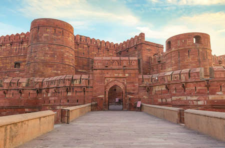 Agra Fort - Historic red sandstone fort of medieval India at sunrise.