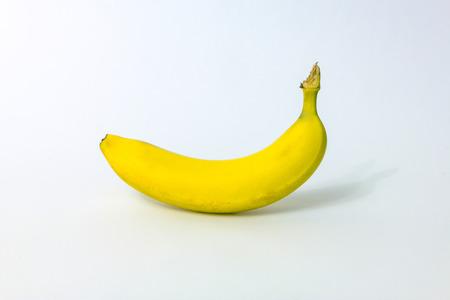 Single ripe banana isolated on white background