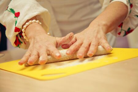 kneading: Woman a hand kneading dough, close-up photo