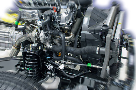 Car engine section with radiator and suspension