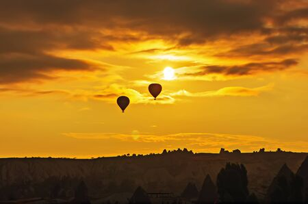 Balloon silhouette with sunrise in the sky photo