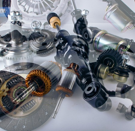 New car parts on a gray background Archivio Fotografico