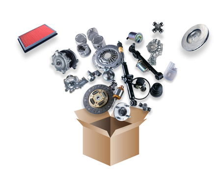 Many spare parts flying out of the box on white background Stock Photo