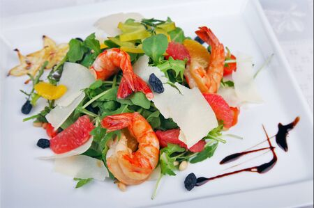 tiger shrimp: Big shrimp and green salad with cheese on plate Stock Photo