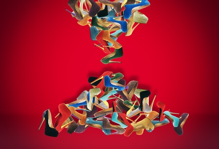 fale: Many womens shoes fale like sand in hourglass. Stock Photo