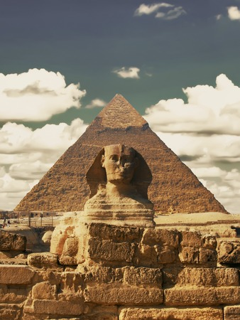 Beautiful profile of the Great Sphinx including pyramids of Menkaure and Khafre in the background on a clear sunny, blue sky day in Giza, Cairo, Egypt