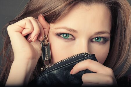 likeable: Beautiful girl with long hair and with green eyes. Serious look. Stock Photo
