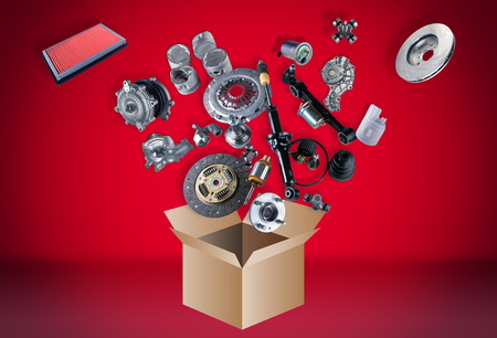 spare parts: Many spare parts flying out of the box on grey background