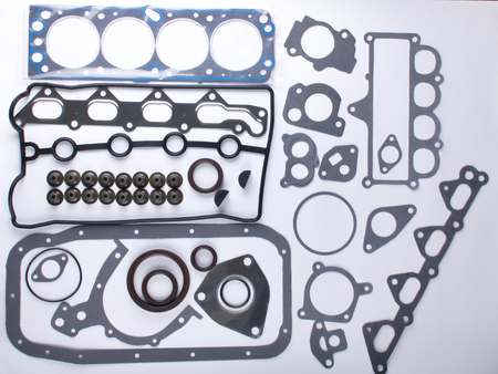 exhaust valve: A large set of gaskets for the engine of a passenger car. Separated on a white background.