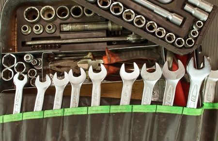 Many dirty set of hand tools on a vintage background
