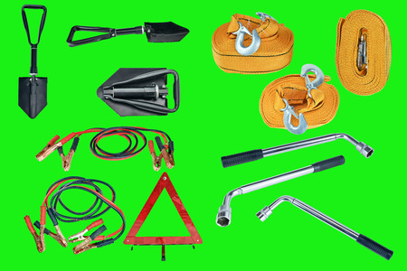 green screen: Elements of the essentials for a passenger car. Danger Safety Warning Triangle Sign, towing rope, fire extinguisher, Jumper cable, wheel wrench and shovel. Green screen, chroma key.