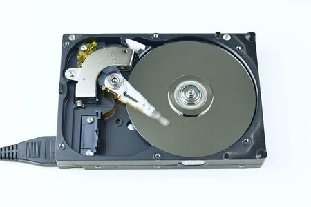 hard drive crash: Isolated hard drive from the computer. Principle of operation. Removing the outer cover, the work head in HDD. Stock Photo