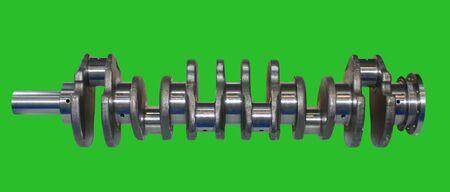 crankshaft: Isolated on green background crankshaft from engine car. Chromakey Green Screen Stock Photo