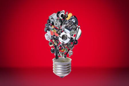 Auto spare parts items in bulb idea. New original equipment spare parts make bulb idea. Many auto spare parts. OEM spare parts in bulb. Auto parts like idea. Stock Photo