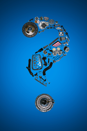 Question mark with auto parts for car. Auto parts for car. Auto parts for shop, aftermarket OEM. Question mark with auto parts. Many auto spare parts isolated in exclamation point