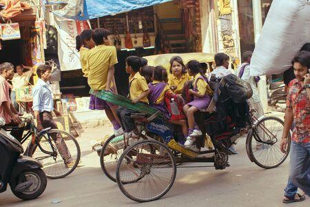 trishaw: Delhi, India, october 19, 2011: Urban form of transport trishaw driven children to school in India.