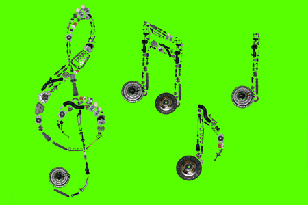 clutch cover: Treble clef assembled from new auto, spare parts. Spare parts for shop, aftermarket, OEM. Treble clef with spare parts. Auto parts for shop. Auto parts for car isolated on green screen, chroma key