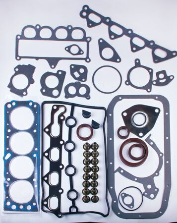aftermarket: A large set of gaskets for the engine of a passenger car. Separated on a white background. Spare auto parts for shop, aftermarket OEM. Isolated set for repairs. Stock Photo