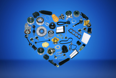 Heart spare auto parts for car on blue background. Set with many isolated items for shop or aftermarket, OEM Foto de archivo