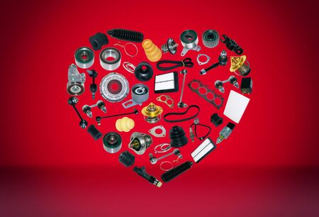Heart spare auto parts for car on red background. Set with many isolated items for shop or aftermarket, OEM
