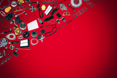 Spare auto parts car on the red background. Set with many isolated items for shop or aftermarket Stock Photo