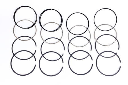 aftermarket: Spare parts for car piston rings on white isolated. New original equipment spare parts