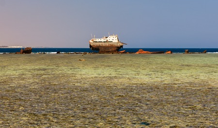 An old shipwreck or abandoned shipwreck. The ship sat on a coral strand and crumbled.