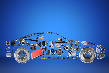 Passenger car assembled from new spare auto parts for shop aftermarket. Isolated on blue background.
