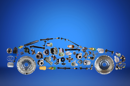 Passenger car assembled from new spare auto parts for shop aftermarket. Isolated on blue background. Reklamní fotografie - 97809121
