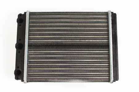 Isolated radiator of stove. New spare auto parts for car. Radiator heater Stock Photo