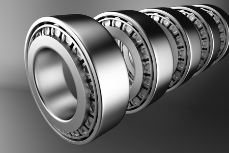 3D rendering. Automotive bearings auto spare parts. Tapered roller bearing isolated on a dark background. Wheel bearing for truck, heavy duty and car. Stok Fotoğraf