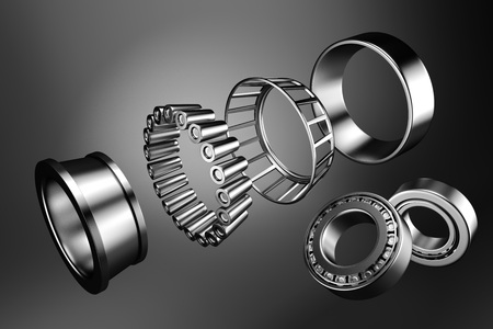 3D rendering. Automotive bearings auto spare parts. Tapered roller bearing isolated on a dark background. Wheel bearing for truck, heavy duty and car. 写真素材