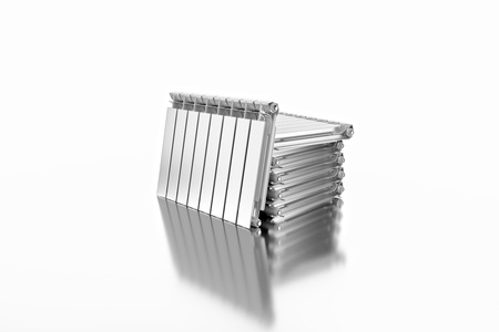 3D rendering. Central heating radiators with many sections. Many white heating radiators on white background. Archivio Fotografico - 119190513