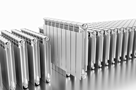 3D rendering. Central heating radiators with many sections. Many white heating radiators on white background. Big choice of water radiators. Archivio Fotografico - 119190517