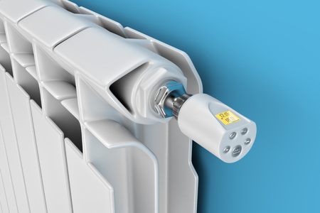 Representación 3D. Radiador de calefacción central con controlador de termostato. Radiador de calefacción de primer plano. Controlador de termostato electrónico para radiador de calefacción. Foto de archivo