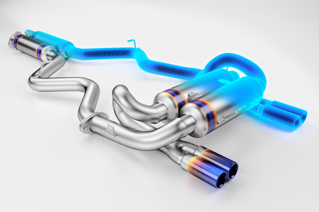 Tuning exhaust system for a sports car. Car muffler, exhaust silencer on a white background