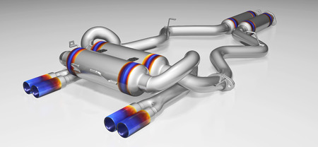 Tuning exhaust system for a sports car. Car muffler, exhaust silencer on a white background. 3D rendering