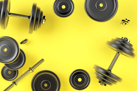 Dumbbell for sports. Bodybuilding equipment on yellow background Imagens