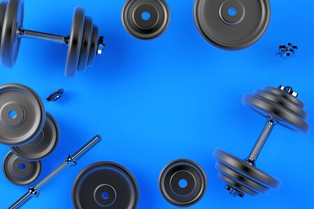 Image of a dumbbell for sports. Bodybuilding equipment on blue background Imagens