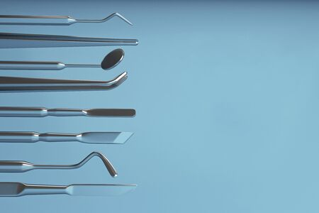 Image of a dentists tools on a blue background. Dentist set tools for inspect of the teeth. 3D rendering. Stock Photo
