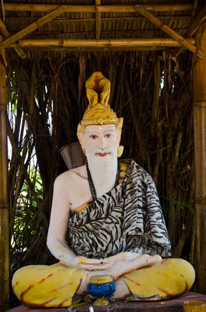 doctrine: Hermit statue sits in the pavilion Stock Photo