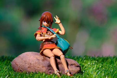supervillian: Doll woman sitting on rocks