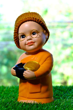 ordain: Close up of monk doll