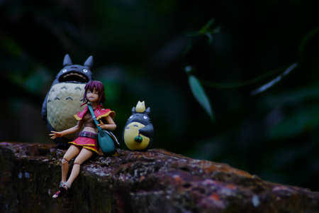 supervillian: Doll girl sitting in the woods