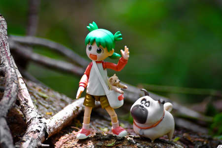 Yotsuba anime figure placed on outdoor nature with net on hand. Yotsuba models are also popular in asia