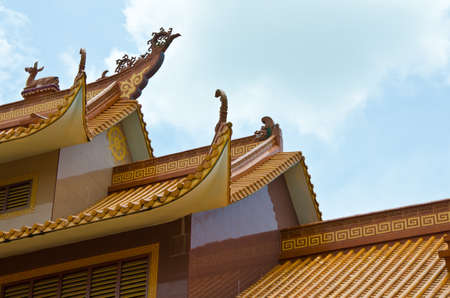 almshouse: Chinese roof structure sky background Stock Photo