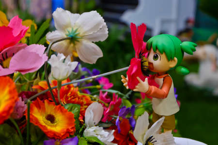 supervillian: Yotsuba anime figure placed on outdoor nature with net on hand. Yotsuba models are also popular in asia