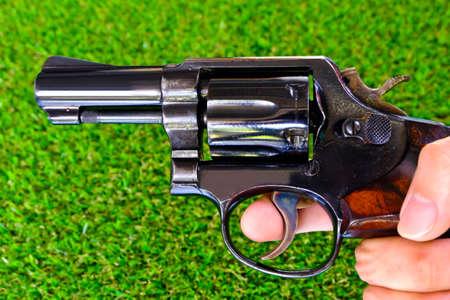 Gun background grass with ammunition. Stock Photo