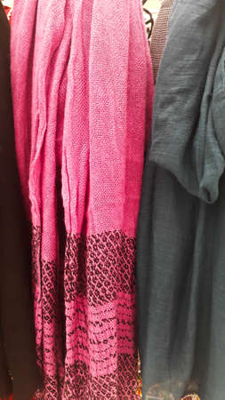 Close-up of colorful scarves hanging in the market