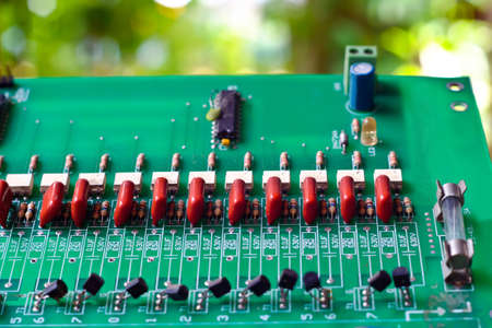 Against the background of old circuit boards naturally compatible. Stock Photo